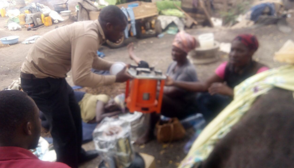 Foster Amede showing Prime Gasifier stoves to end-users